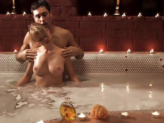 Mia Magma is with her boyfriend in the jacuzzi and making out with him. She makes him stand up so she can see his nice thick cock. She sucks on him ha
