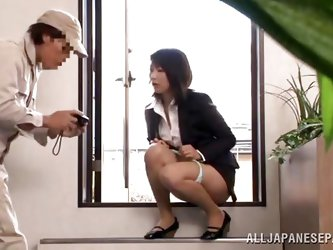 Japanese cunt wants to piss, but doesn`t know where. She asks a worker, but he doesn`t help her and she pisses outside the building. He follows her an