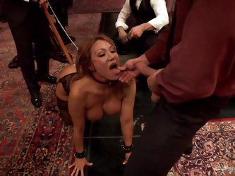 A busty brown-haired milf wearing stockings and high heels is humiliated by a man while others stay and watch all the kinky event. The perverse game i