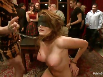 The main attraction of the night is the hot bitch Kenzie. She is brought blindfolded and with her hands tied at her back. Everybody is having fun with
