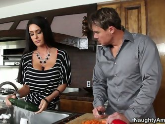 Jessica Jaymes seduces her husband with her short sexy skirt. She starts to suck his cock and then enjoys his pokes right on the kitchen table.