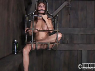 Hazel is a dungeon slave. Her master puts her legs in stirrups and restrains her to the table. Her puts a speculum in her pussy so her can see deep in