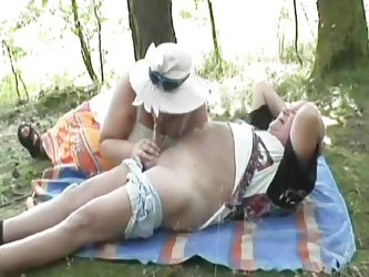 This grandpa and grandma are having a nice picnic in the woods. They take a break from eating sandwiches to fucks each other. The old lady sucks the o