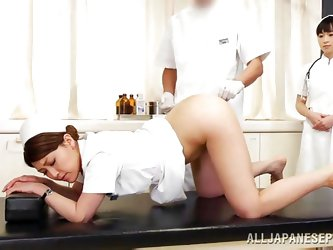 At this Japanese doctor's office there is lots of anal play going on. The doctor puts on the latex gloves and lubes up the nurse's tight but