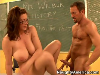 Not passing exam this slutty red haired nerd unzips teacher's jeans for sucking a dick. Wearing glasses she rubs cock in her hands licking balls.
