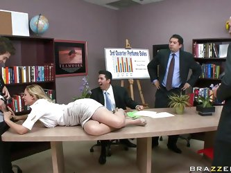 Julia Ann is doing a presentation and is getting buzzed by Xander via remote control vibrator. Every time he pushes the button, her button gets pushed