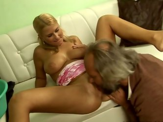 Lusty blonde girl with ponytails is getting her pussy licked by horny old grandpa. His beard tickles her pussy while he eats cherry. Then she gets on