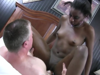 A good looking ebony bimbo with small tits and dark nipples is getting her wet cunt pounded by a white dude that has a large cock. The guy is doing so