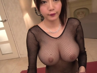 That fishnet onesie make Japanese babe's tits stand out even more, and they're already massive. She bends down and starts gobbling on stiff