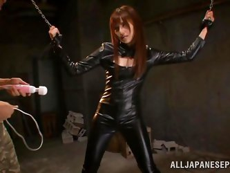 A slutty Japanese with brown long hair has been captured and isolated down in the basement. She cannot escape, as her hands are tied up from the ceili