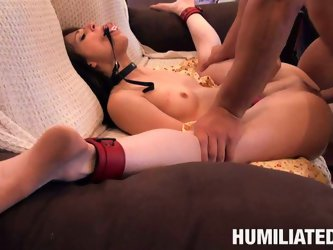 Dirty and nasty slut fucking hard with her hand tight up and wearing gag. She is thrusted from behind and later jumping on a cock like crazy.