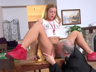 Old master orders pizza and while young delivery girl is counting money begins to caress her long legs and round ass. After nice cunnilingus, she is r