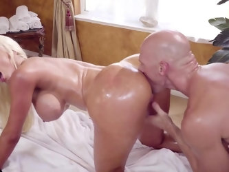 Nicolette Shea wants to relax in the new spa with her favorite partner named Johnny Sins. Blonde hottie reveals her oiled up body and enjoys some hot