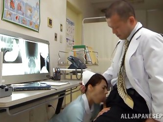 This nurse checks in with the doctor do see if the x-rays are ready but the only thing he has prepared for her is his stiff cock. she gets down on her
