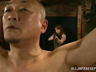One of the cute female slaves is tied up in the sex dungeon and taunted by her master, as the mistress watching. The mistress is not pleased with the