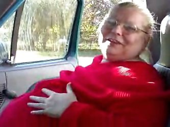 That disgusting morbidly obese granny is my wife's grandma. She pulls her red sweater up and starts playing with her ugly pale skin saggy tits.