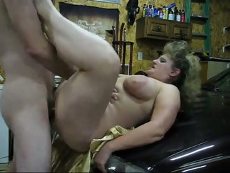 Voluptuous mom with big boobs and fat ass came to my garage and begged me to fuck her hard. I screwed her cunt missionary style on top of the hood.