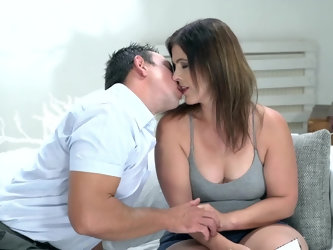 He knows she's horny for his young cock and has no trouble seducing this old lady in her living room. A little kissing is all it takes to get her