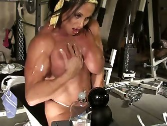 Now that chick can easily take over any guy. Muscular brunette pleases herself with a huge dildo on webcam in the gym.
