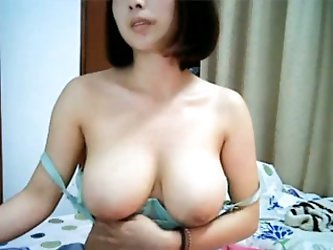 This hot brunette Asian lady exposed her majestic pair of big tits on livecam. Pretty lady was proud of them and I couldn't take my eyes off them
