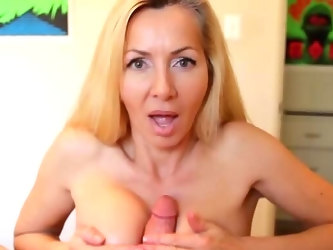 Needy mom likes the wet dong between her generous tits