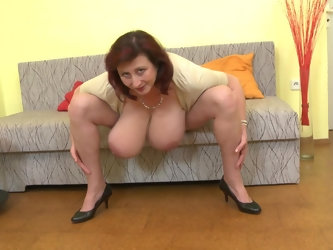 Mature redhead amateur Jana P. exposes and licks her enormous tits