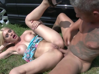 Blonde in shorts Kitana Lure in a reality outdoor doggy style session