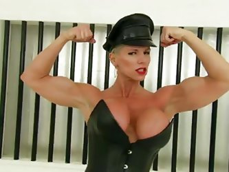 Her name is Goddess Heather and she dominates like one. She has muscles as well as pretty big boobs. She fucks the bitch out of every whore she gets.