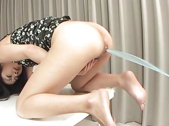 Check out this Japanese milf, she likes it i the butt and damn she's fucking hot. The man inserts liquid in her anus and when she's all fill