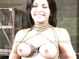 Our brunette smiles at the thought she's about to be humiliated and fucked. She loves bdsm and as the executor ties her up and squeezes her tits