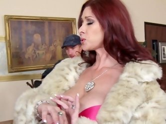 A redhead gets out of her fur coat and she then receives a large dick