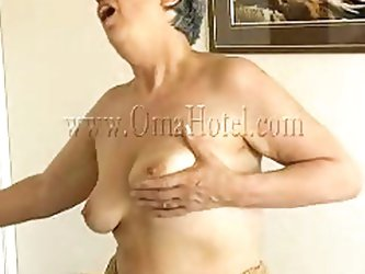Sexy granny Rosa takes her clothes off and reveals that saggy tits of hers. She squeezes them for more pleasure and lays down on the bed. The horny ol