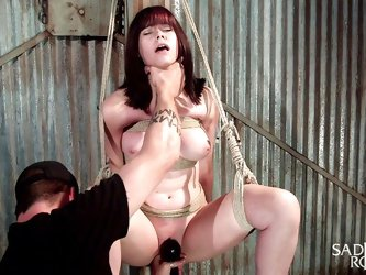 Katt's horny pussy is fingered deep as the bitch is tied up in a fierce rope bondage, with no possible way out from the dark basement. With one h