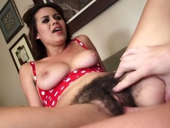 A chick with a hairy pussy is getting fucked really hard