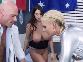A blonde and a brunette are participating in a hot and kinky threesome