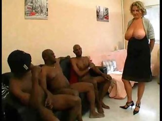 BUSTY WOMAN WITH SEVERAL MEN FUCK