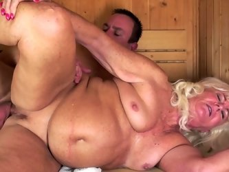 A fat old chick is fucked in the sauna by a big young stallion