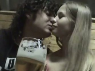 Sweet light haired lady drinks beer with her boyfriend. After some time she gets tipsy and lets her fucker suck her soft tits and rub her teeny pussy.
