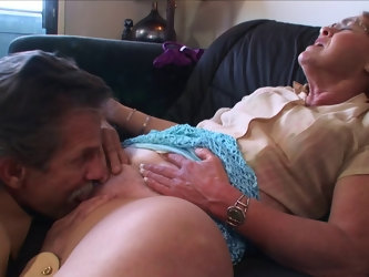 Fucking in the living room with a mature couple who love sex