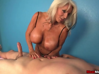 Mature slut with giant fake knockers pleasures a naked dude