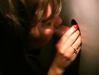 Wife at gloryhole with hubby watching