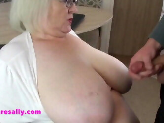 Mature Sally enjoying a big tits cum bath