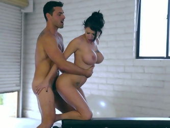 Incredibly good and sexy looking busty babe Peta Jensen is poked on table