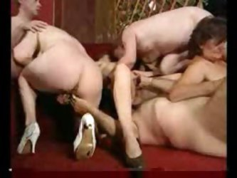 Mature swinging orgy party in the bar