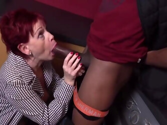 Caroline is a mature redhead who can't hold back from fucking black guys and eating fresh cum