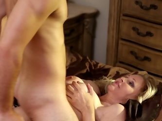 A big breasted mature woman is fucked on the bed really hard