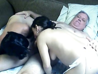 Look how two lusty black haired moms share one old prick in FFM scene. Those skanks give blowjob sucking that dick in turn.