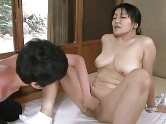In a moment of compassion the mature Nippon lady undresses and gives her body to this boy. He licks her tits and then fingers her cunt as she shows hi