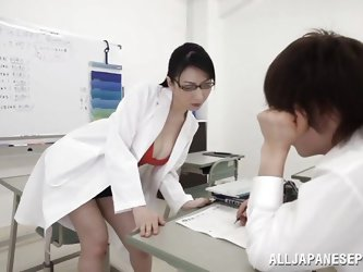 This student is in needs of some one on one tutoring with his teacher, Hitomi Oohashi. She kisses him passionately and tears his clothes off. She lick