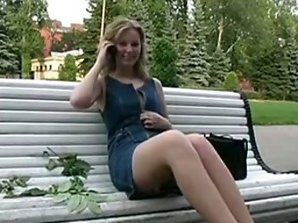 My gorgeous blonde babe with sweet knockers undresses in the park on the bench. She is looking awesome and the random men don't mind at all.